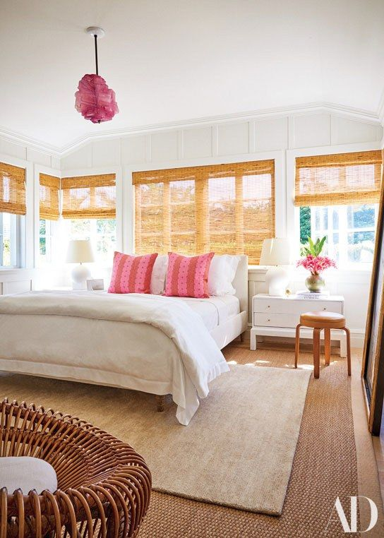 A Thaddeus Wolfe glass pendant hangs from Audrey's bedroom ceiling. Austin  Harrelson-designed nightstand