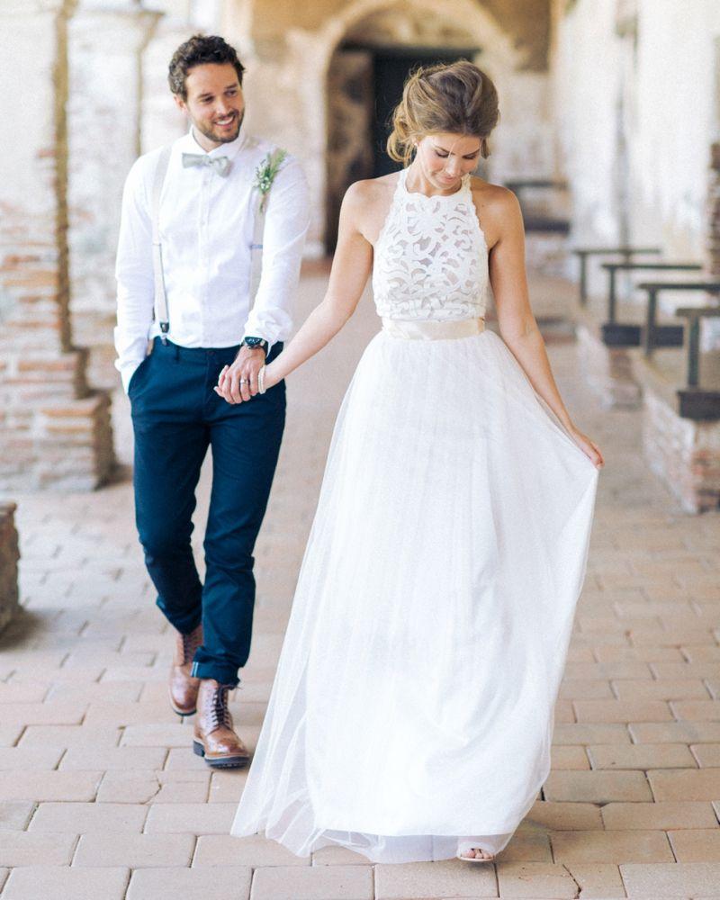 Lace wedding dress halter  Bride  Groom walking  Katie  Pete  The Villa San Juan