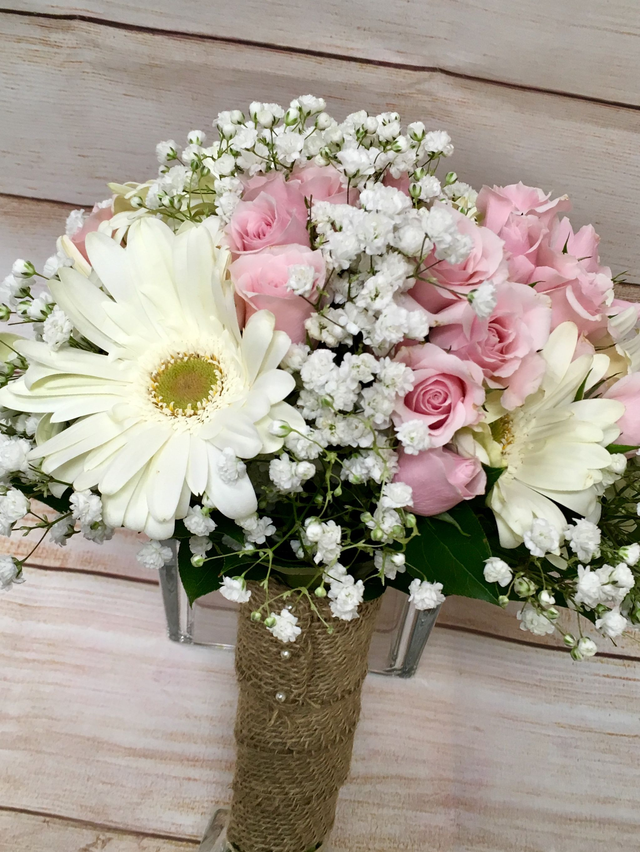 A Rustic Hand Tie Bouquet Using White Gerbera Daisies And Babies Breath And Accents Of Pink Spra Flower Bouquet Wedding Pink Rose Bouquet Gerbera Daisy Bouquet