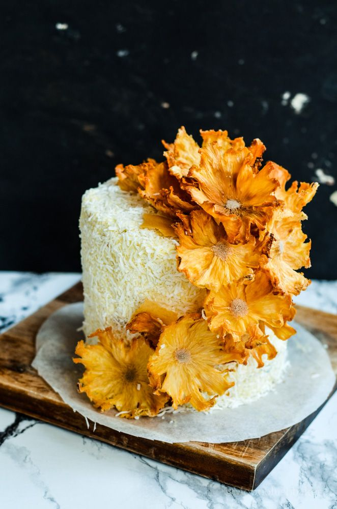Layered Passion Fruit Butter Cake With Coconut Cream Frosting And Pineapple Flowers Made Out Of