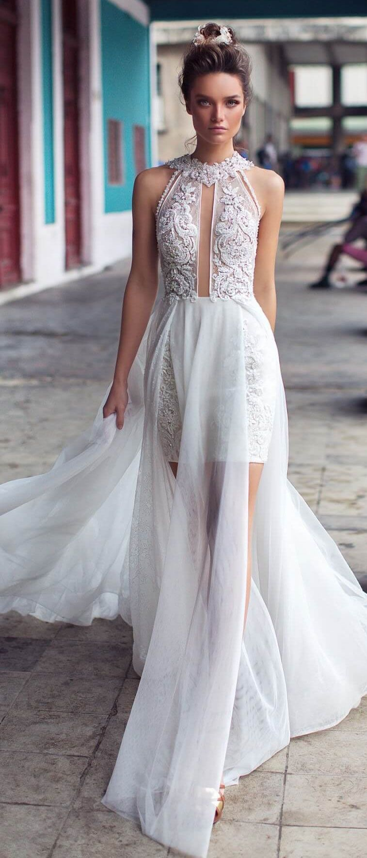 Embroidered and beaded lace float over the bodice and skirt while a