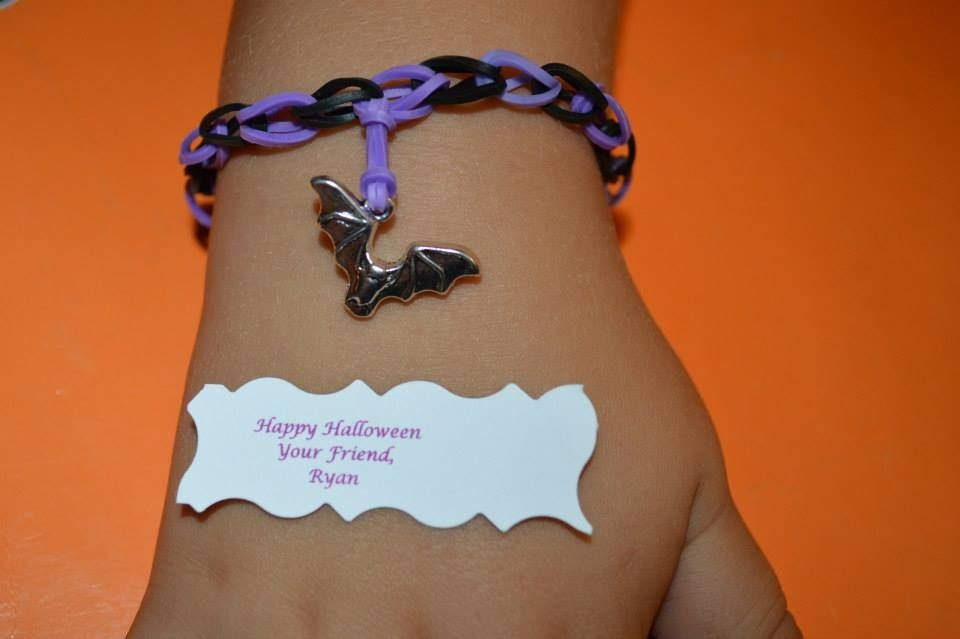 Halloween rainbow loom bracelet with bat charms made or my son's classroom..  Go like my Facebook page at www.facebook.com/CharmedLifeByKim or shop at www.etsy.com/shop/charmedlifebykim
