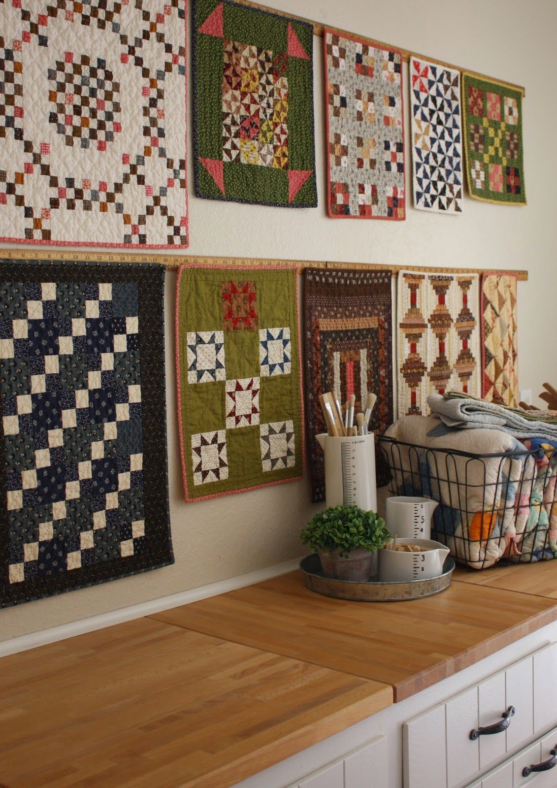 Living With Little Quilts Love the ruler used to hang quilts