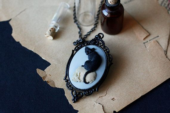 Black cat on a skull cameo - gothic macabre pendant on Etsy, $35.00