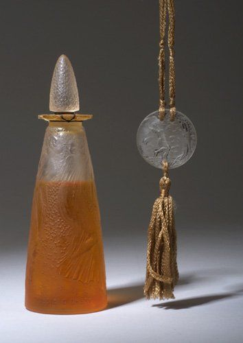 "R. LALIQUE ""Poesie"" perfume bottle for D'Orsay, circa 1914, in clear and frosted glass, sealed, together with a Lalique style Fioret pendant on a silk cord. Perfume bottle molded R. LALIQUE, pendant engraved Fioret Paris."