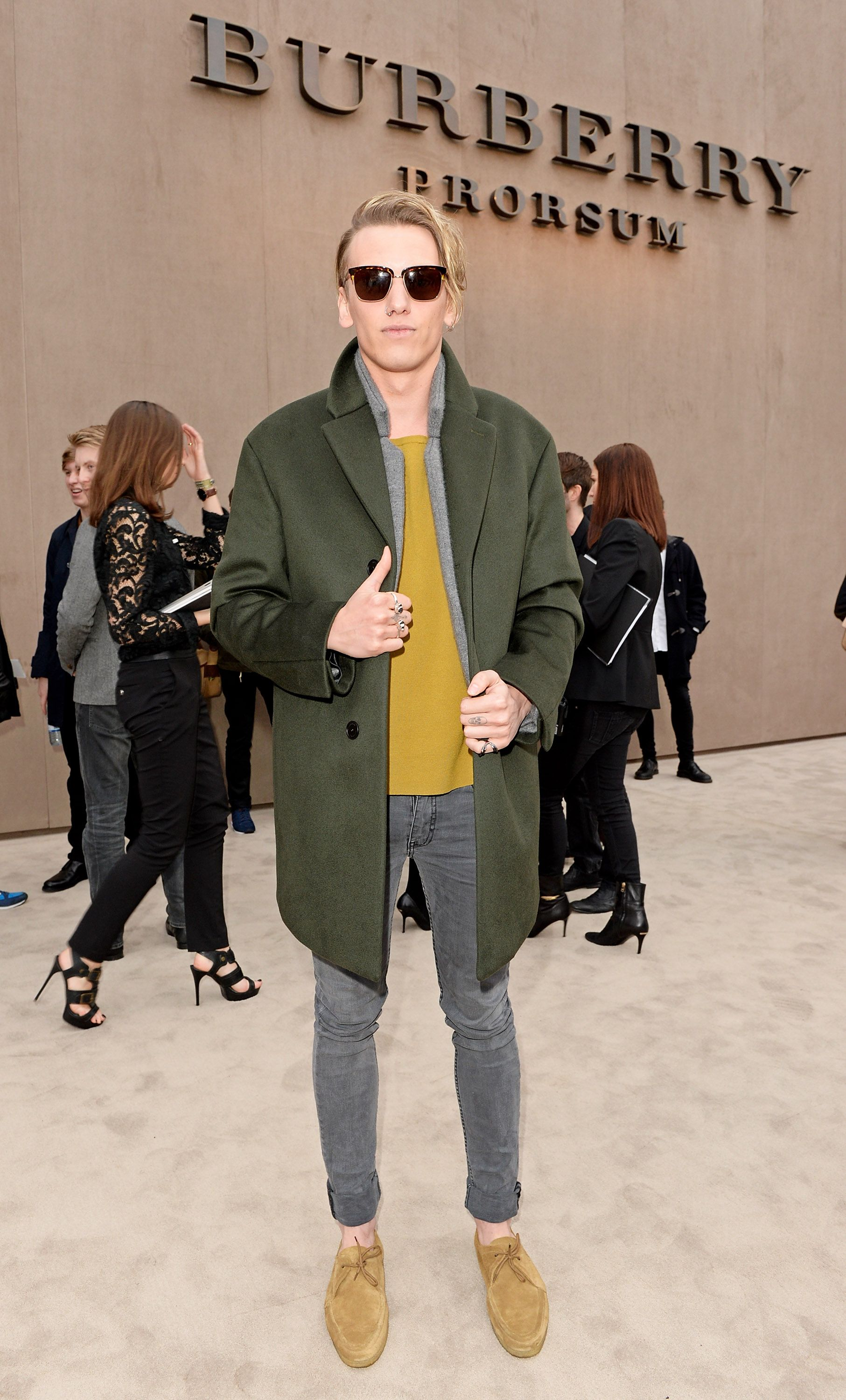 British actor and S/S14 campaign star Jamie Campbell Bower wearing Burberry and sunglasses from The Trench Collection outside the Prorsum Menswear A/W14 show space in London
