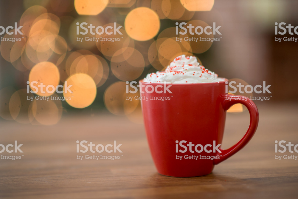 A Red Mug Of Hot Chocolate Sits With Whipped Cream And Red Sprinkles Hot Chocolate Christmas Stock Photos Chocolate