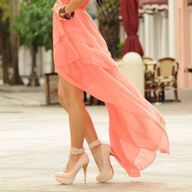 Coral dress with a tail and pastel pink heels