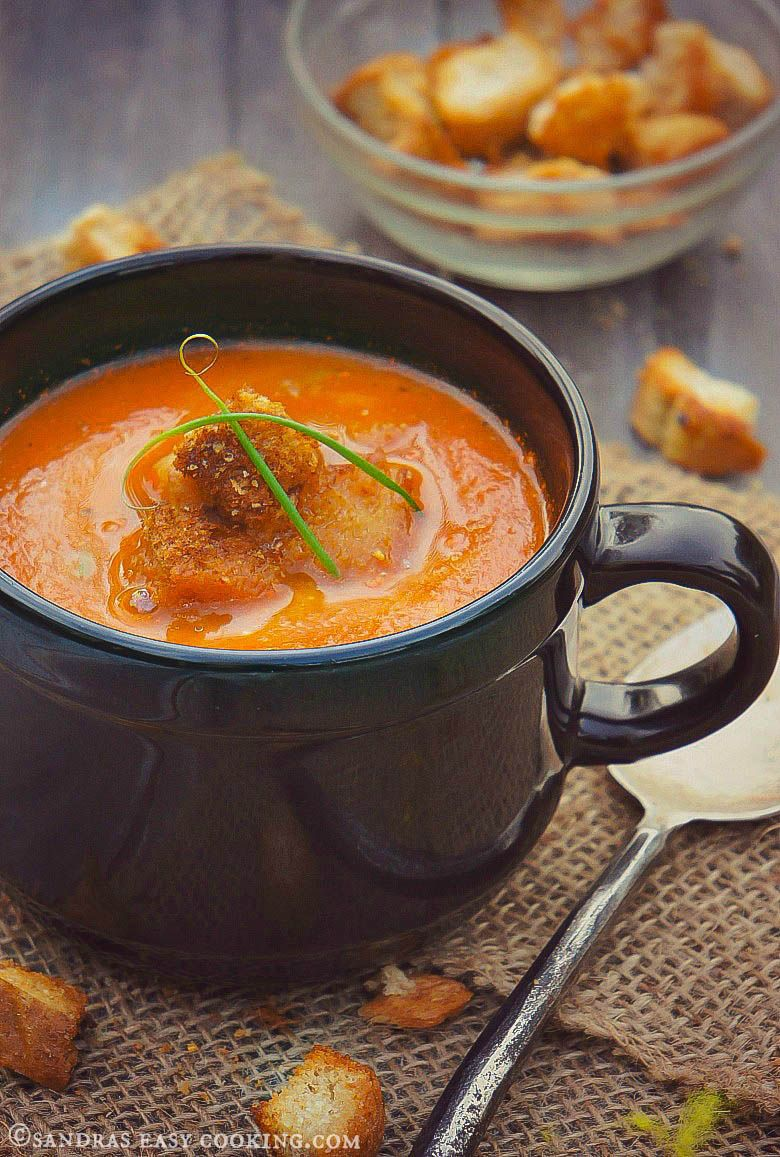 Homemade recipe for simple Roasted Tomato Soup with toasted parmigan croutons