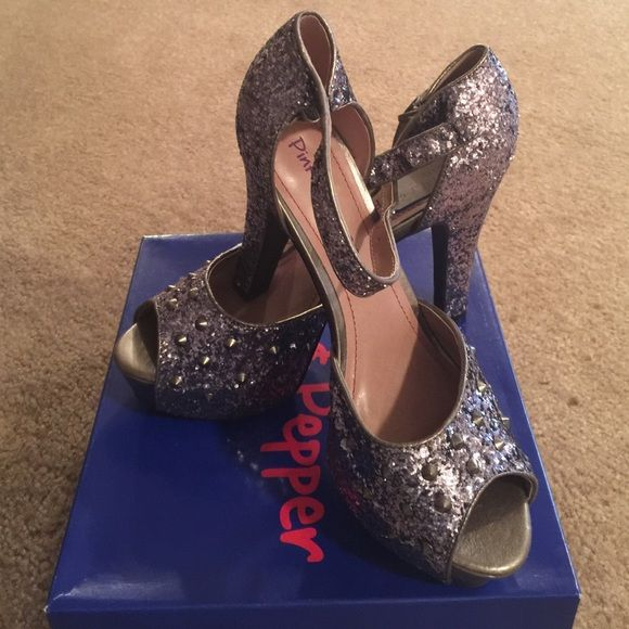 Pink and Pepper Glitter T-Strap heels Pink and Pepper sparkly high heels. Never worn. Great to paid with a dress for a night out on the town! These are great to dress up any outfit. Pink and Pepper  Shoes Heels