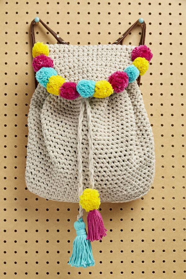 How to jazz up a backpack with all the poms! (And tassels) #backpacks