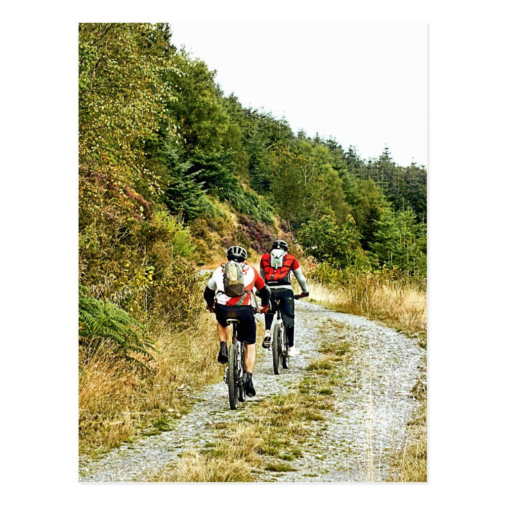 Two men mountain biking in the hills of Wales.
