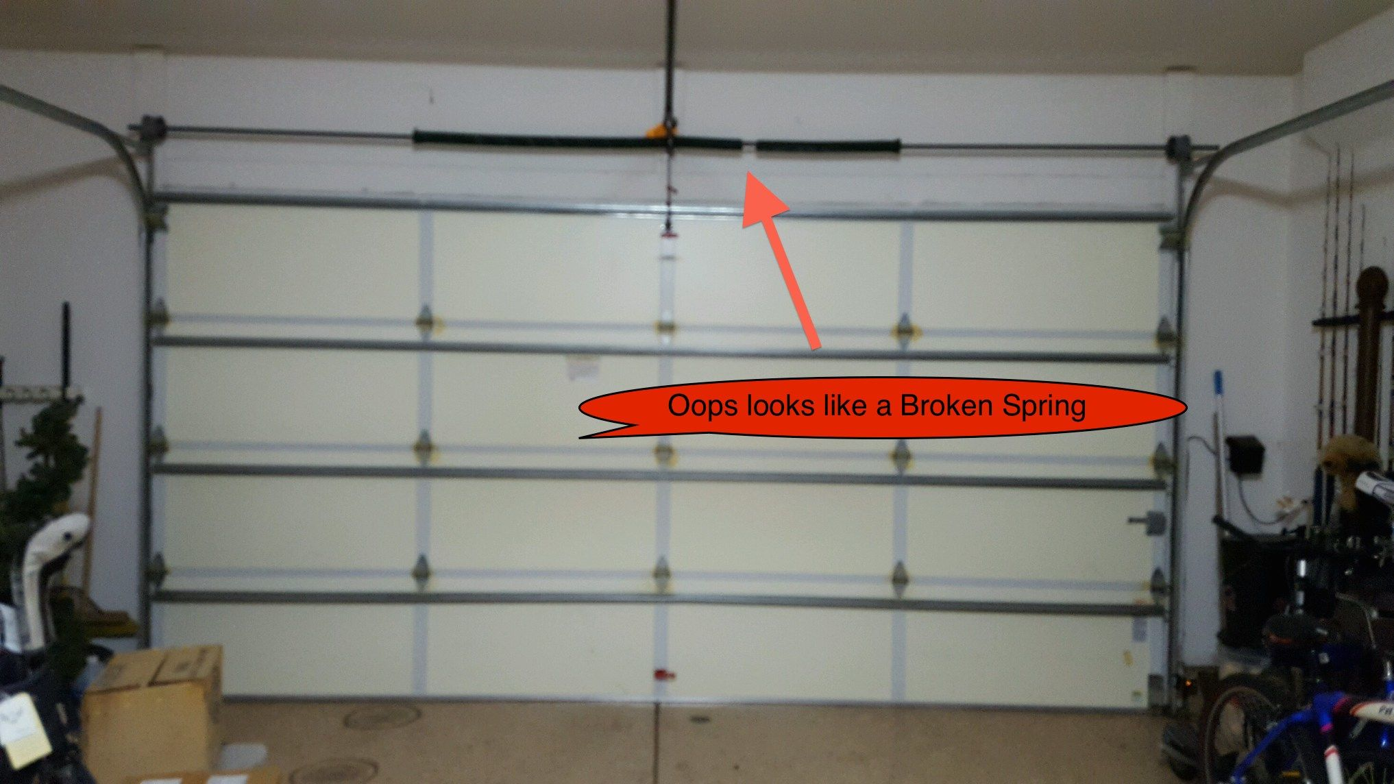 Broken Oil Tempered Garage Door Spring On A 2 Car Sectional Garage