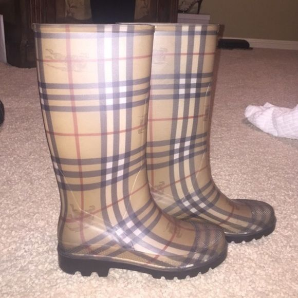 Authentic Burberry Rainboots Authentic Burberry rubber Rain boots in a size 38 (US 7) Received these as a gift and they were too small. Worn less than 5 times and in PERFECT condition....as good as new. These boots allow anyone to stay trendy in any type of weather with these trendy, yet practical boots! Burberry Shoes Winter & Rain Boots