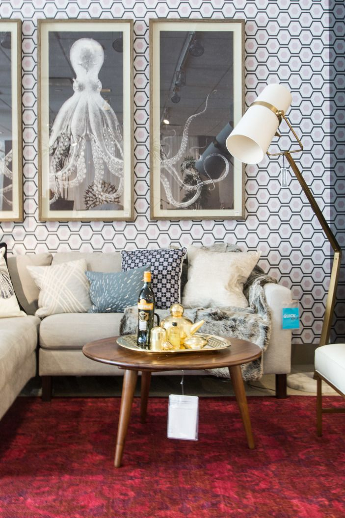 Removable wallpaper makes it even easier to take the visual interest up a notch without feeling like you're committing to something too crazy. And sectional sofas give you more seating while taking up less floor space.