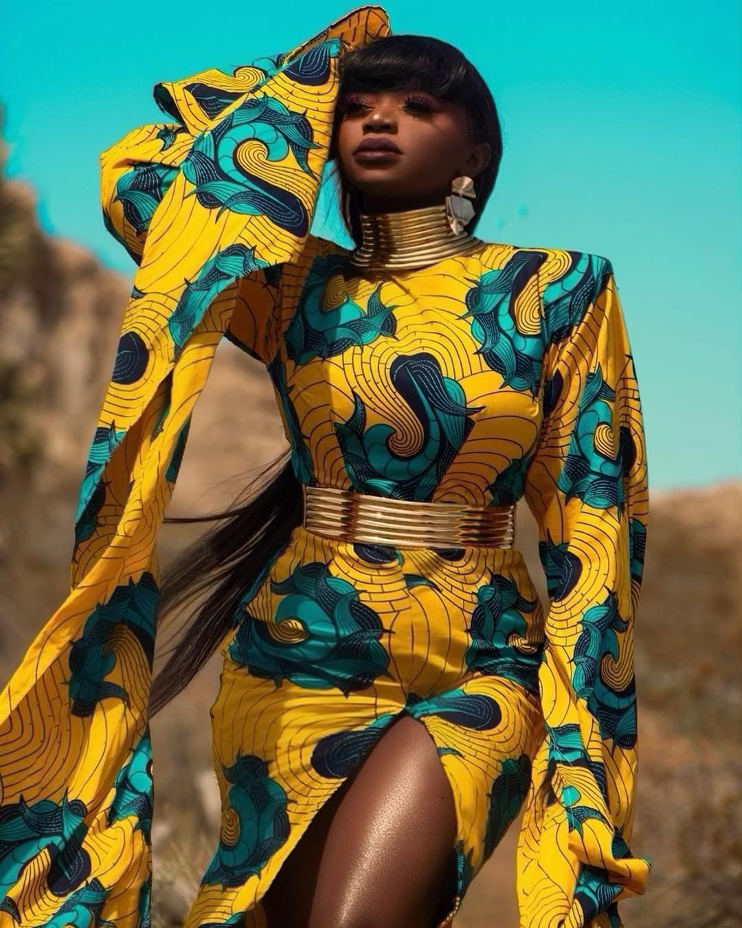 Claude Kameni of Lavie by CK  #afrikanischerdruck Angolan supermodel Maria Borges spotted in an over the knee mini flare dress with open back AND HALTER NECK details by designer Claude Kameni of Lavie by CK #afrikanischerdruck
