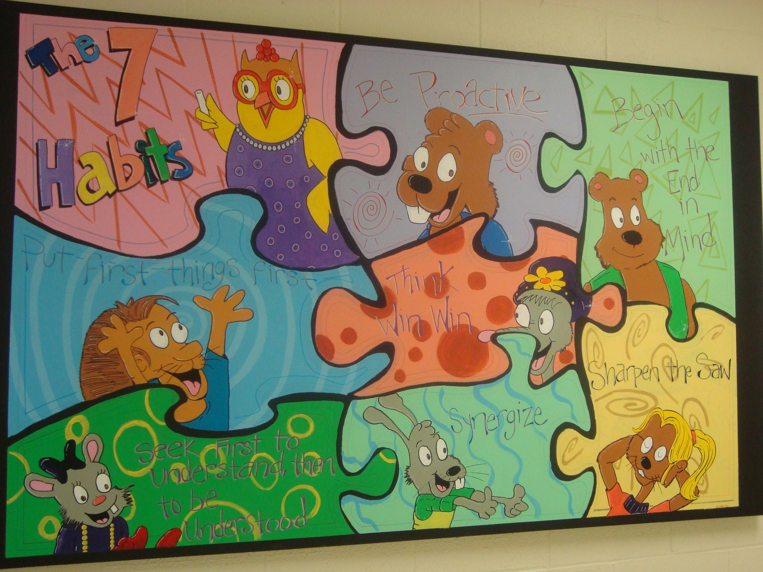 Art teacher painted a collage of the 7 habits characters for 7 habits tree mural