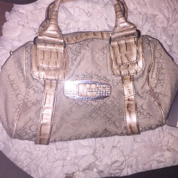 e8449e74f5 Authentic Guess tote Studded Guess symbol. Outside in good condition. A  couple stains in the inside however barely noticeable! Guess Bags Totes