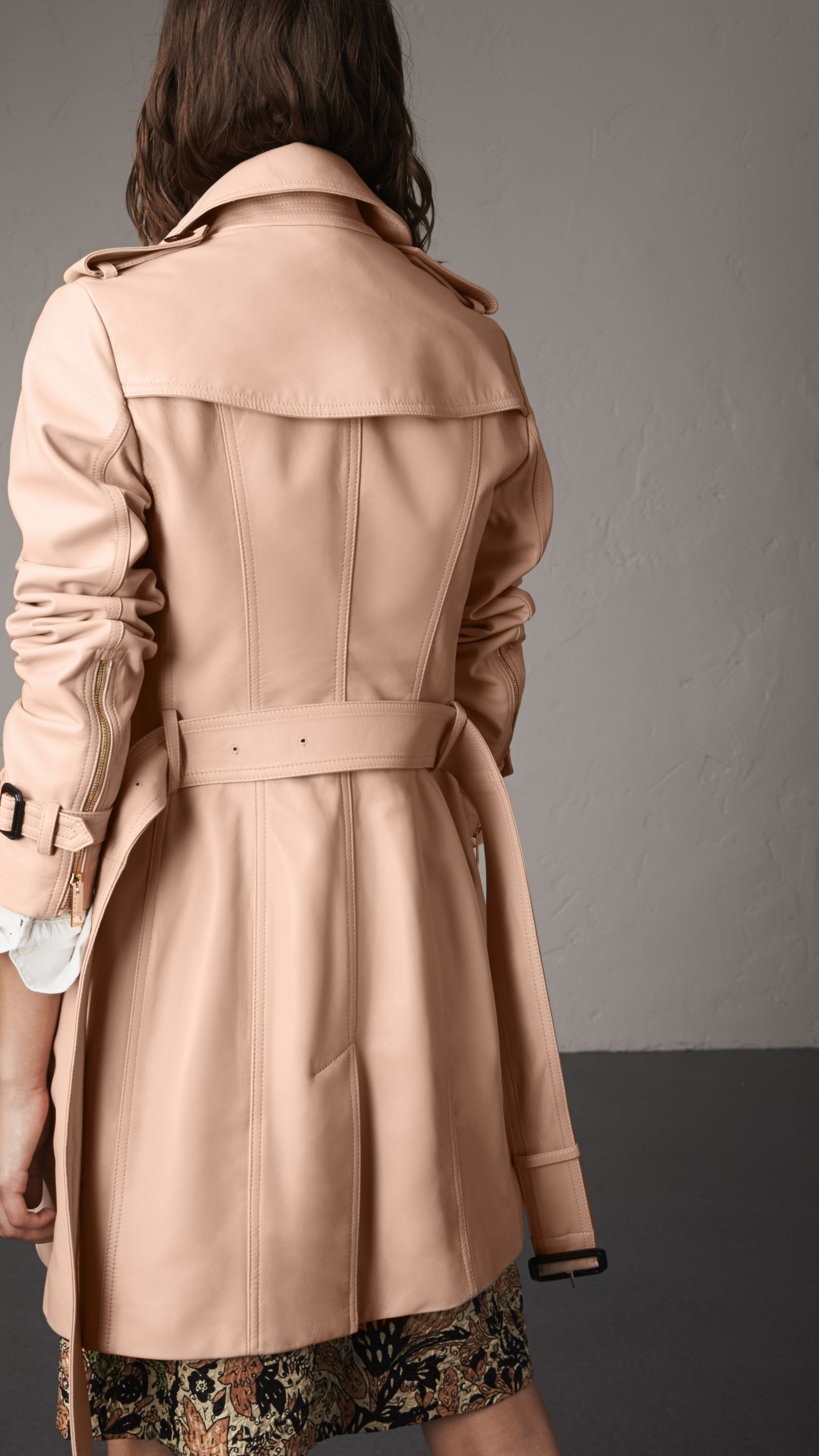 Nude women in leather trench coats