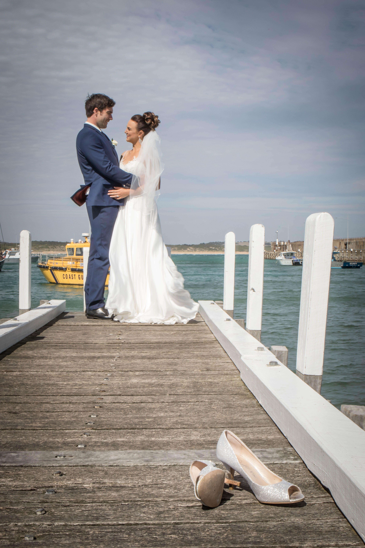 Johanna Watts Wedding Photography Bride and Groom kicking there ...