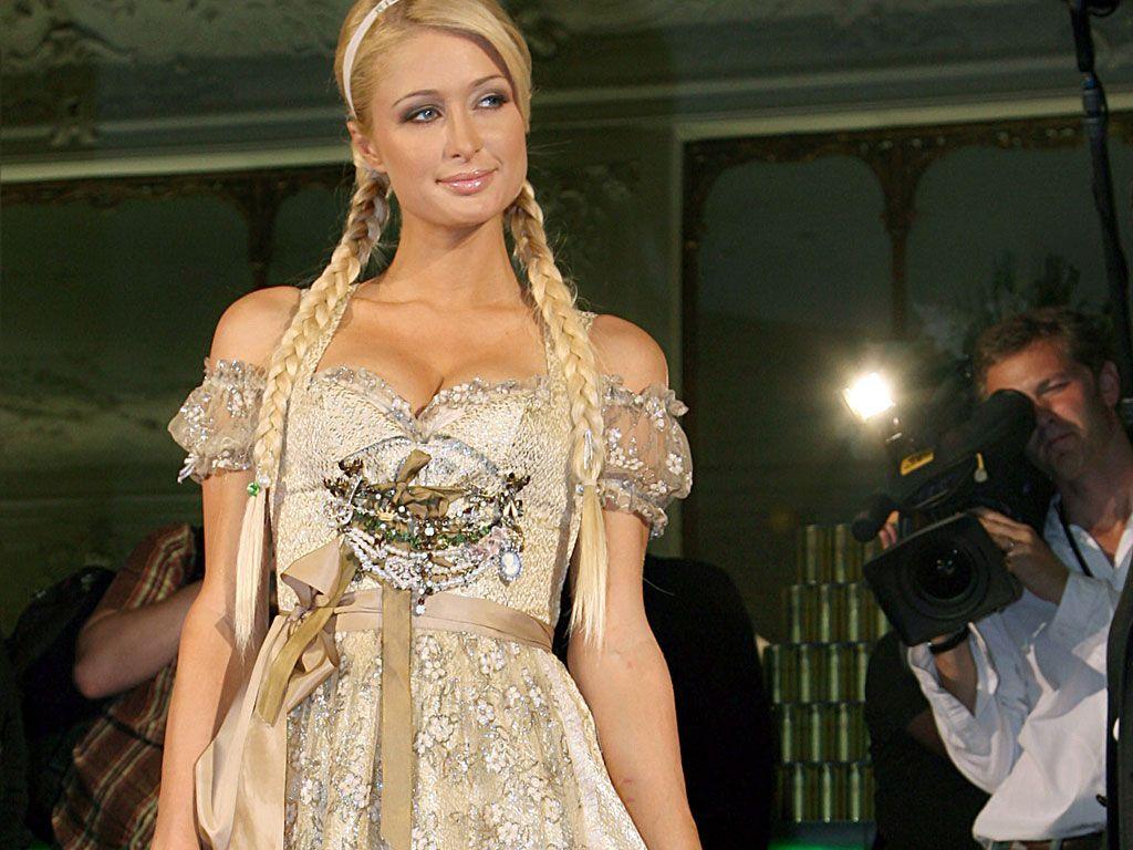 Paris Hilton at Oktoberfest wearing a Golden Dirndl by German designer Lola Paltinger.