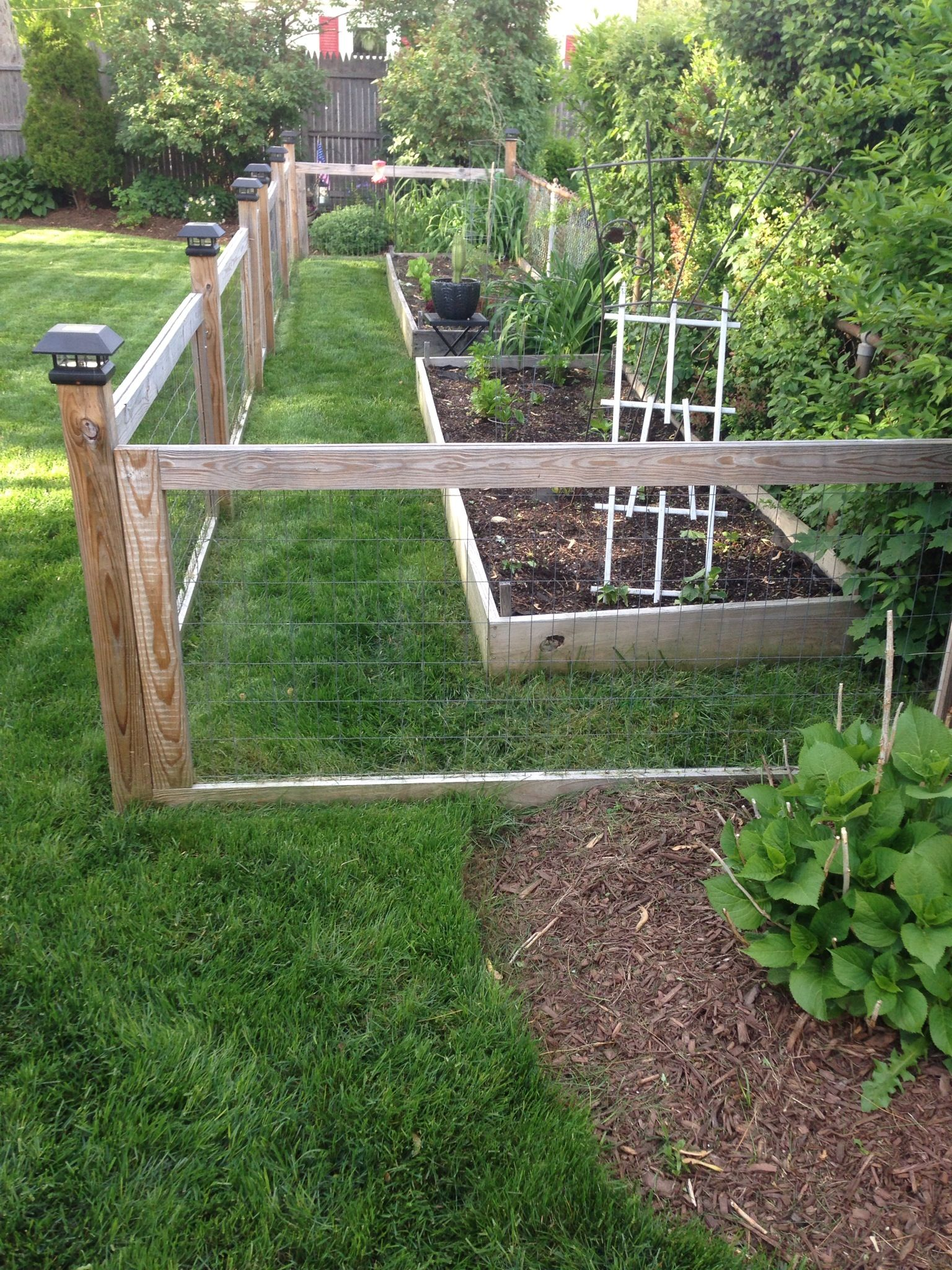 Homemade garden fence with raised beds gardening and for Garden bed fence ideas
