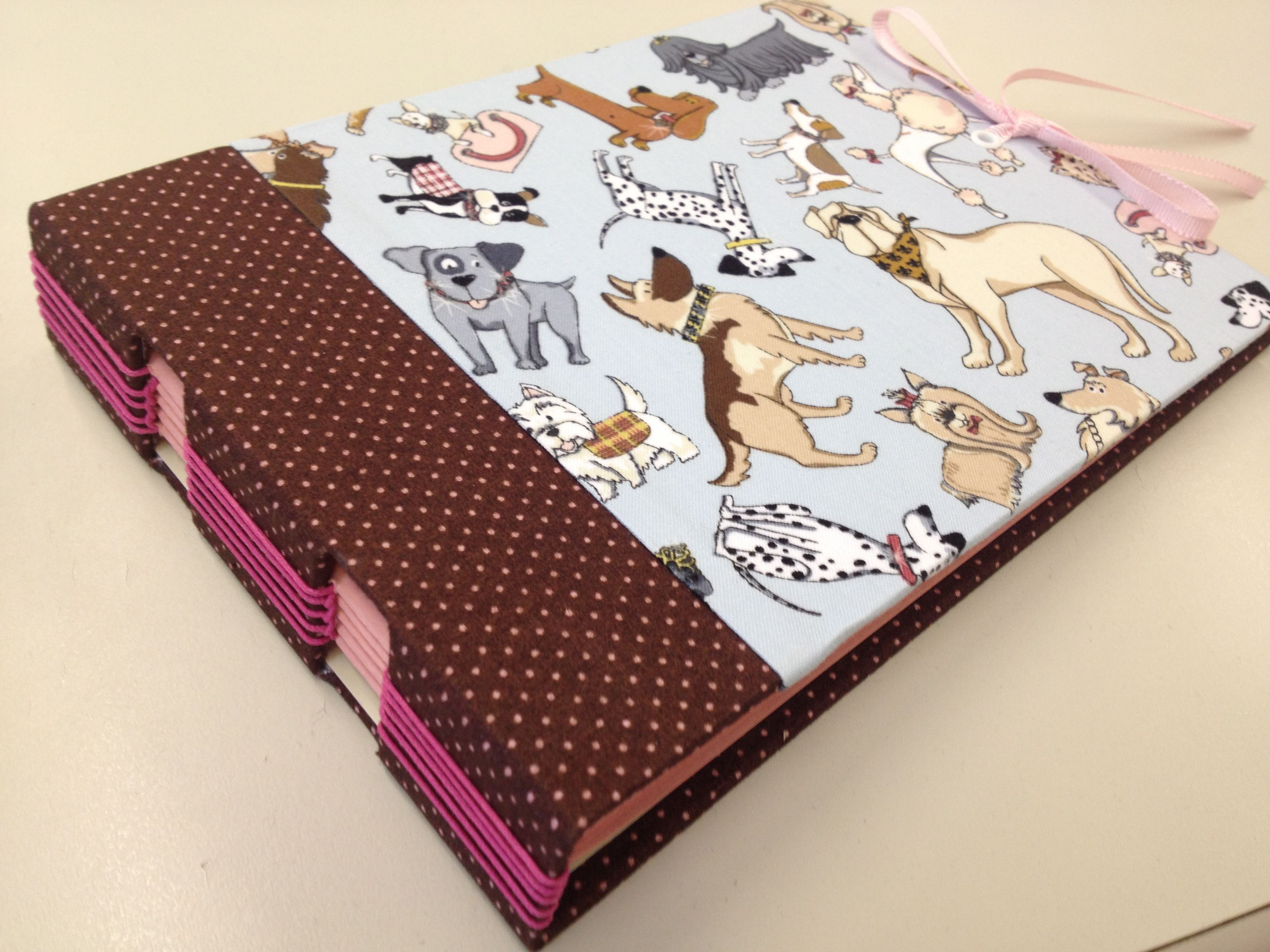 "From my ""pet series""! Funny dogs on the cover and longstitich bookbinding."