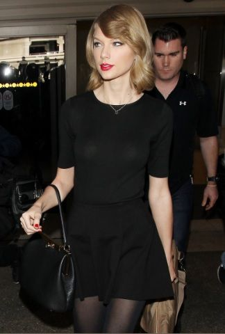 Taylor Swift Her Short Hair and Her Guitar Arrive at LAX Airport