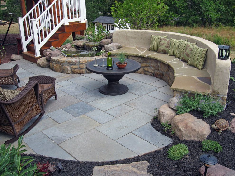 Outdoor Paver Patio With A Stone Bench In Maryland