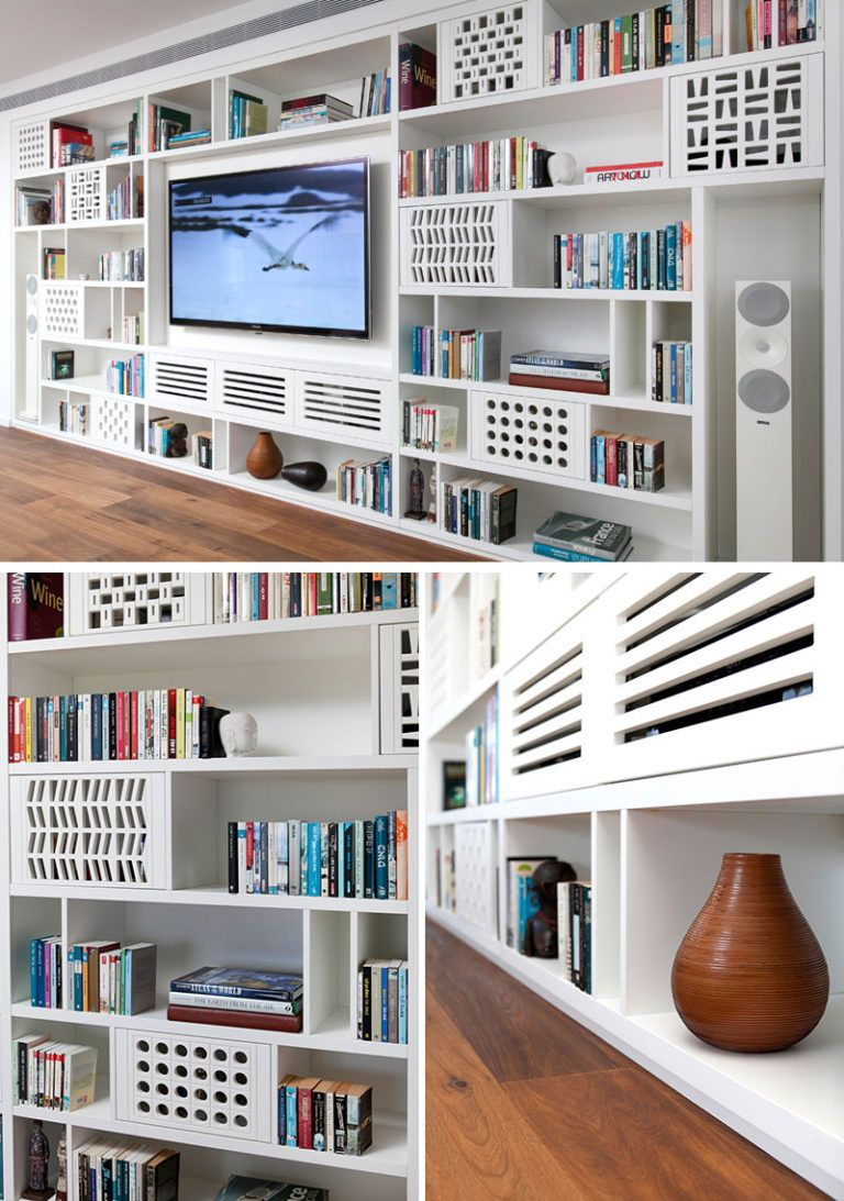 A Wall Of Custom Designed Shelving Was Added To This Apartment Bookshelves In Living Room Media Room Design Shelving Units Living Room