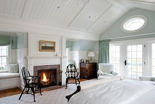 Traditional Master Bedroom with Ballard Designs Baldwin Chair, Wainscotting, specialty window, can lights, Cathedral ceiling