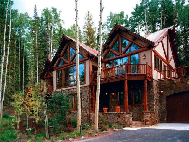 Shanty Creek This Stunning Modern Log Home Design Features Flared Post Porch Columns Custom Stonework And Stu Home Building Design Log Cabin Plans Log Homes