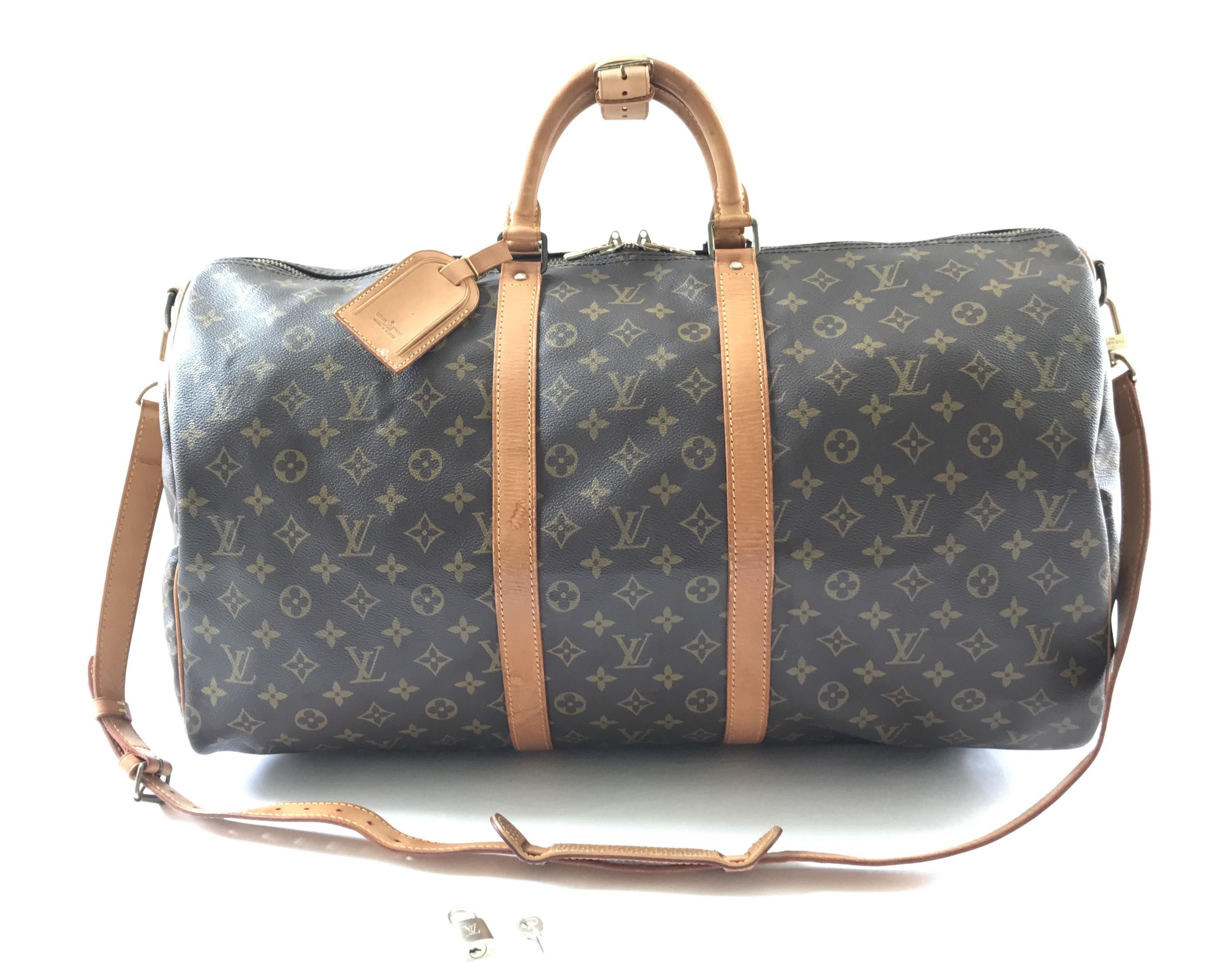 2a2d8de15733 Save 70% on the Louis Vuitton Monogram Canvas Keepall Bandouliere 55 Brown  Travel Bag! This travel bag is a top 10 member favorite on Tradesy.