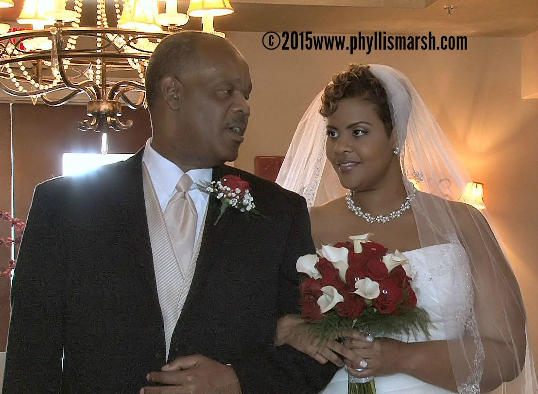 Shenae and her dad right before going down the aisle.  http://www.phyllismarshvideo.com
