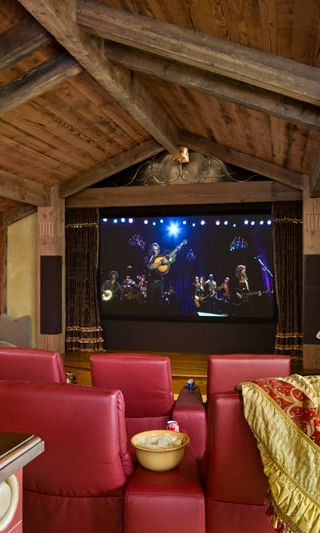 Stunning Rustic Home Theater By Locati Architects With Red Chairs And Exposed Wood Cathedral Ceiling