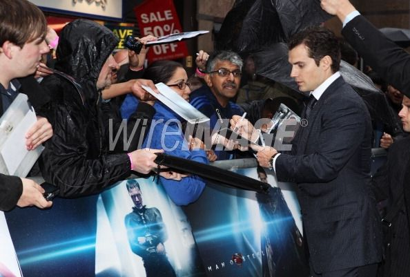 Actor Henry Cavill signs autographs...