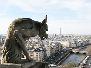 #Paris #France Notre-Dame Cathedral, Gargoyle - Chimera - the river Seine and the Eiffel Tower in the background