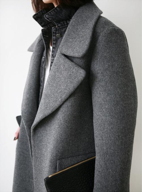 White tee, denim shirt, gray flannel coat.