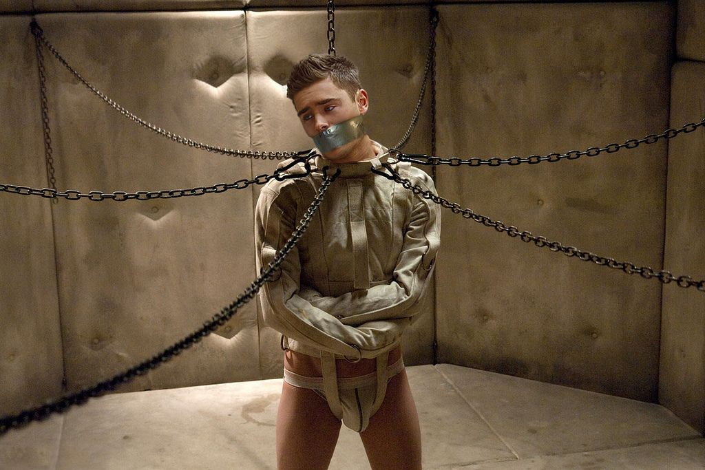 Restrained. Chained. Gagged. Straitjacket. Padded Cell. Jock strap ...