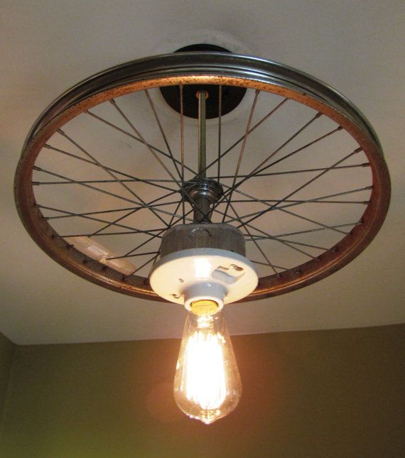 hanging ceiling light made from repurposed bike by