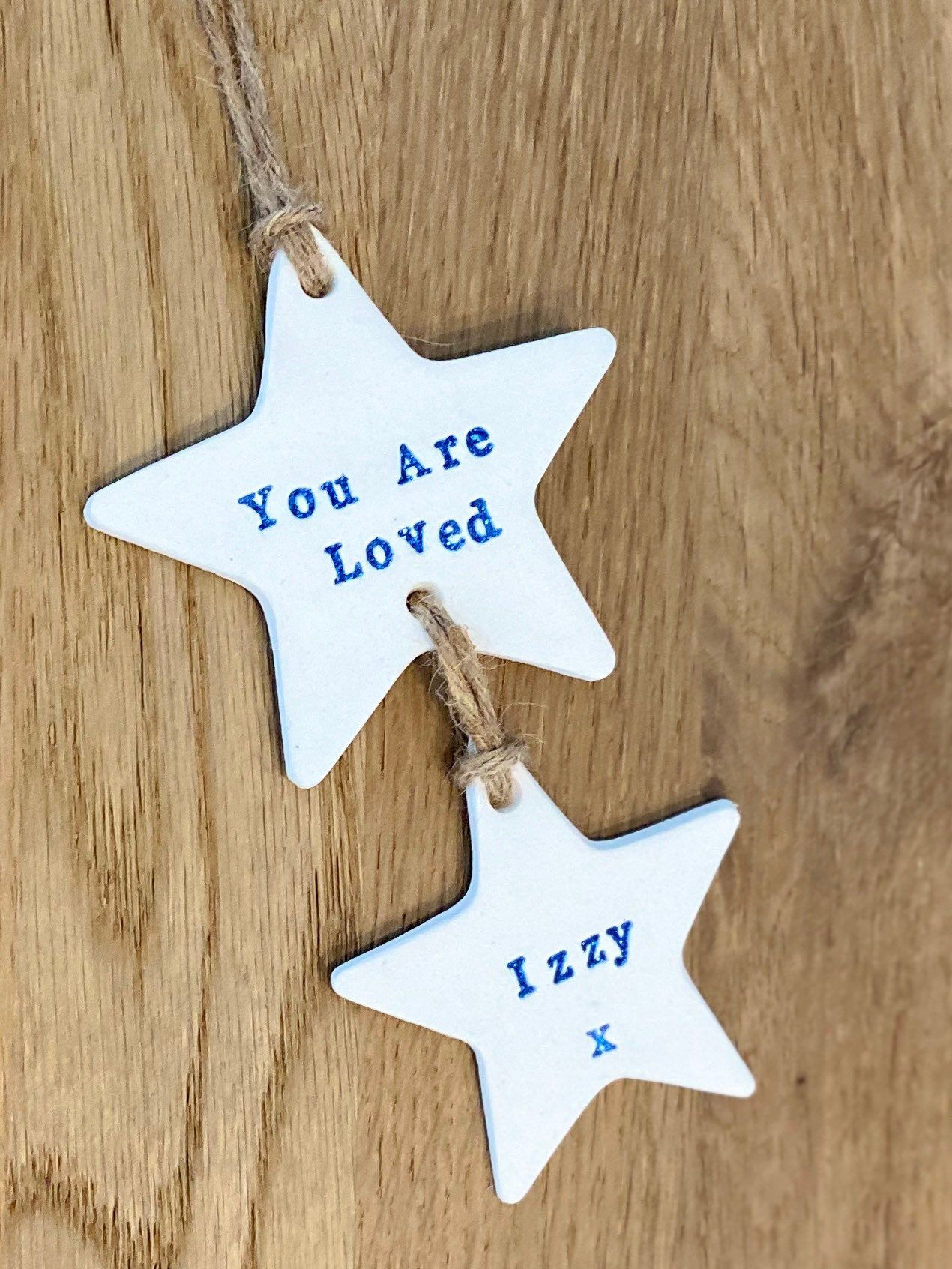 """Excited to share this item from my #etsy shop: Personalised """"You Are Loved"""" Wall Hanging #imprinted #memories #youareloved #clay #handmade #gift #walldecor #hangingdecoration #stars"""