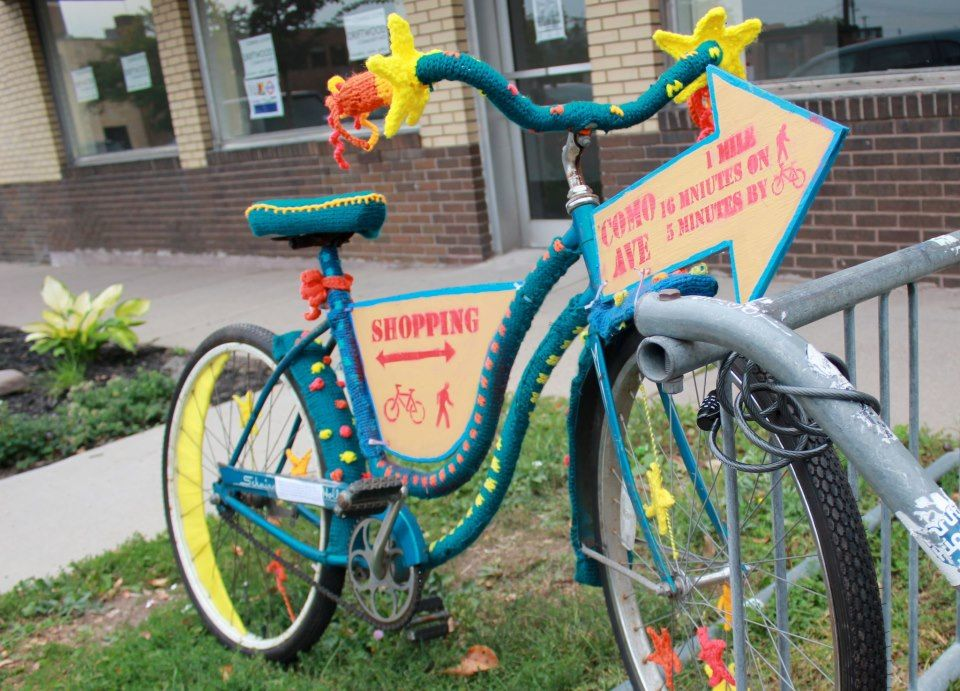 Yarn-bombed bike by Amy Sparks on Raymond Ave in St. Paul part of an Irrigate project by artist Carrie Christenson.