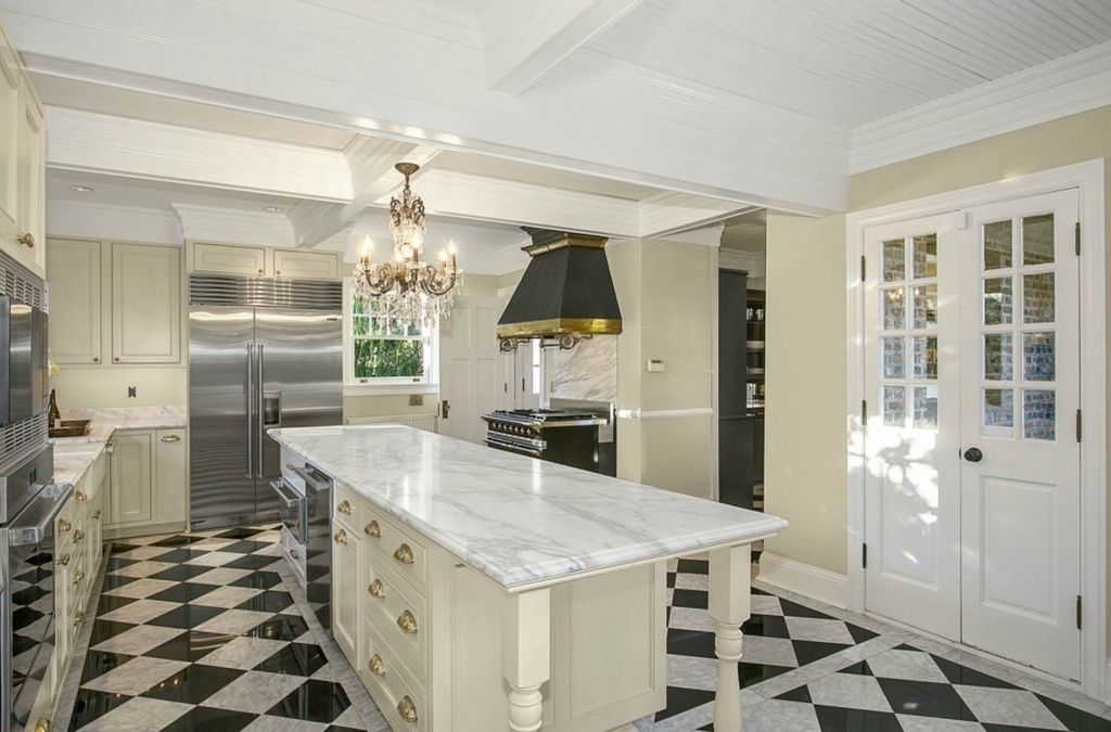 Attractive Kitchen Features Black And White Checkered Marble Flooring, With Large White  Wood Island Featuring Expanse