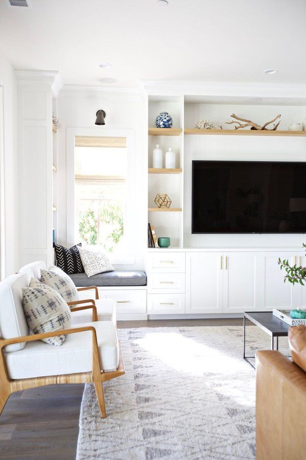 White built ins in the living room, white cabinets, brass fixtures