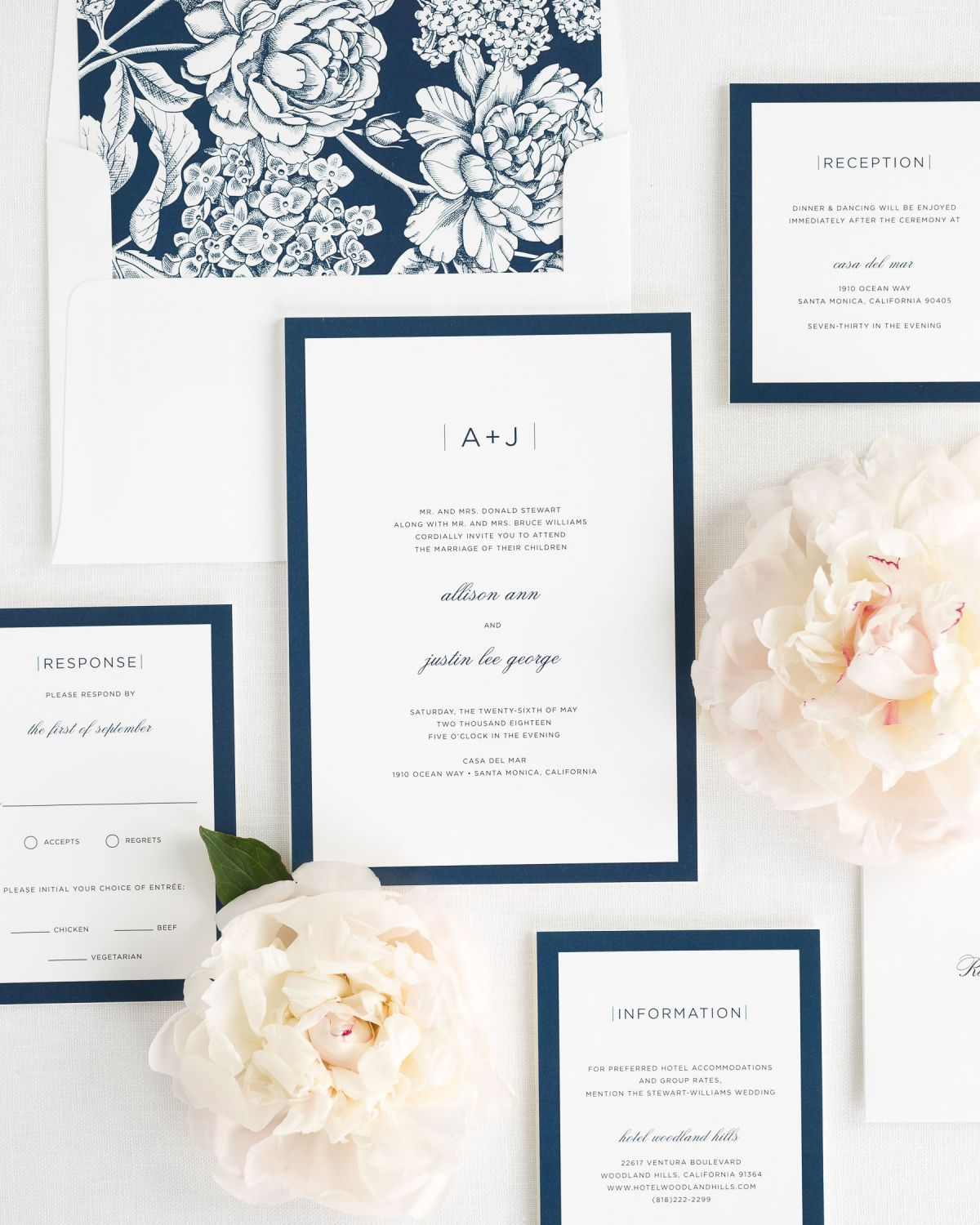 wedding invitation package with navy envelope liner reception