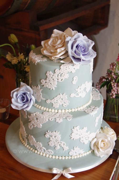 Pale mint round wedding cake with custom sugar roses.