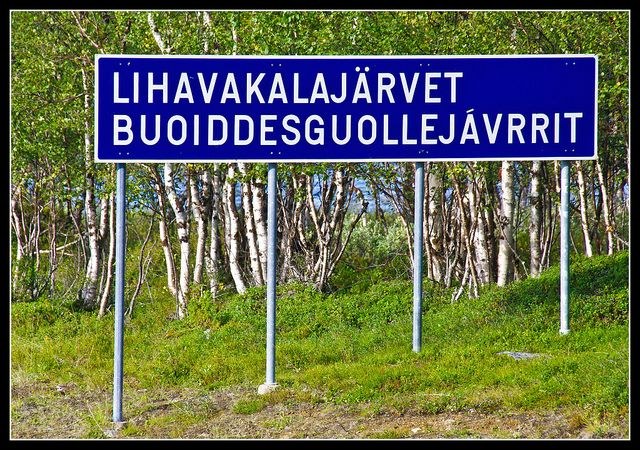 """Road sign:  """"The Fatty Fish Lakes.""""  Top line is Finnish/bottom line is Sami (Lapland)--the language like no other!"""