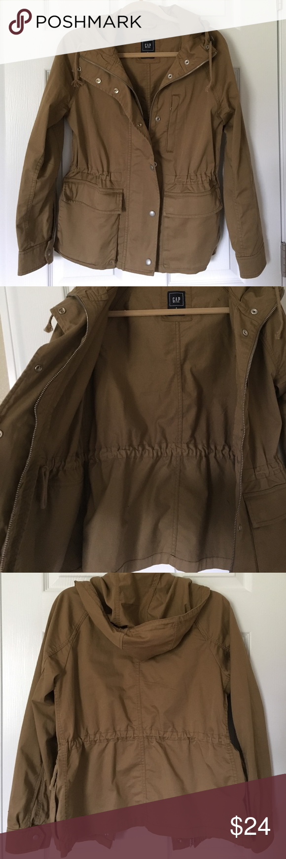 Gap utility jacket Gap utility jacket. Perfect for spring. Hood, adjustable waist, outer pockets with snap closure. Zipper and snaps in the front. Chest pocket with zipper. Size small. Camel/tan color. Small mark on front that will probably come out in wash. GAP Jackets & Coats