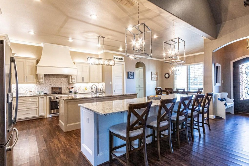 2 Kitchen Islands And Beautiful Lighting Over Each With Beautiful