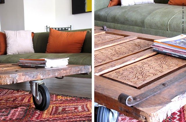 ethnic door on casters = brilliant coffee table!